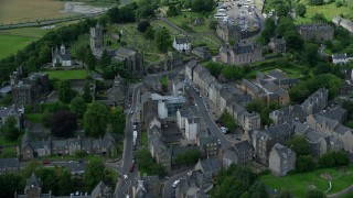 AX109_033 - 6K stock footage aerial video fly over residential buildings along King Street, reveal church in Stirling, Scotland
