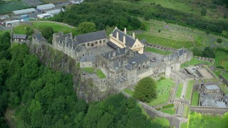 AX109_039 - 6K stock footage aerial video orbiting historic Stirling Castle, Scotland