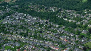 AX109_056 - 6K stock footage aerial video of a residential neighborhood with trees in Stirling, Scotland