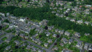 AX109_057 - 6K stock footage aerial video of a residential neighborhood and trees, Stirling, Scotland