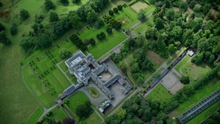 AX109_060 - 6K stock footage aerial video of Keir House surrounded by trees, Scotland