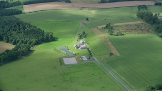 AX109_061 - 6K stock footage aerial video approach sheep farm, Stirling, Scotland