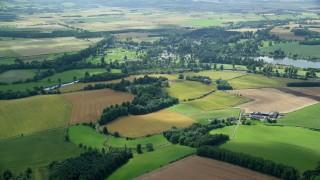 AX109_063 - 6K stock footage aerial video of farm and farmland, Blair Drummond, Scotland