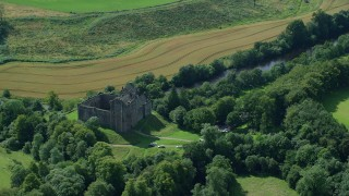 AX109_066 - 6K stock footage aerial video flyby historic Doune Castle and trees, Scotland