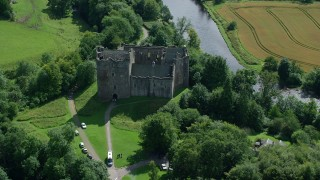AX109_068 - 6K stock footage aerial video of orbiting Doune Castle and a river, Scotland