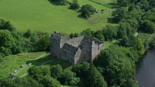 AX109_069 - 6K stock footage aerial video orbit of historic Doune Castle and river, Scotland