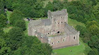 AX109_071 - 6K stock footage aerial video of orbiting Doune Castle with tourists on the grounds, Scotland