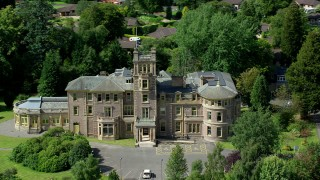 AX109_086 - 6K stock footage aerial video front of Manor Hall Center for Trauma, Doune Scotland
