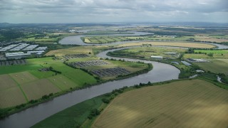 AX109_102 - 6K stock footage aerial video of River Forth among farmland, Scotland