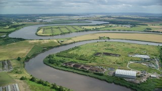 AX109_104 - 6K stock footage aerial video of River Forth and farmland, Fallin, Scotland