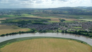 AX109_106 - 6K stock footage aerial video flyby River Forth and a small village of Fallin, Scotland