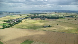 AX109_111 - 6K stock footage aerial video approach farm fields and village of Airth, Scotland