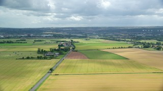 AX109_116 - 6K stock footage aerial video of farms and farm fields by A905 highway, Falkirk, Scotland