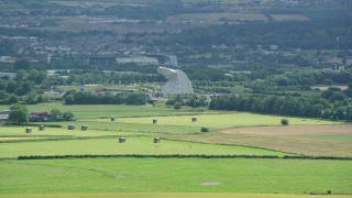 AX109_117 - 6K stock footage aerial video approach The Kelpies sculptures from farmland, Falkirk Scotland
