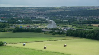AX109_120 - 6K stock footage aerial video approach The Kelpies sculptures from fields, Falkirk, Scotland