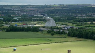 AX109_121 - 6K stock footage aerial video approach The Kelpies sculptures, Falkirk, Scotland