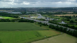 AX109_122 - 6K stock footage aerial video approach The Kelpies sculptures and M9 highway, Falkirk, Scotland