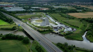 AX109_123 - 6K stock footage aerial video of The Kelpies sculptures and M9 highway, Falkirk, Scotland