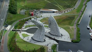 AX109_124 - 6K stock footage aerial video of orbiting the iconic Kelpies sculptures, Falkirk, Scotland