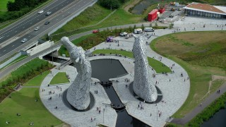 AX109_125 - 6K stock footage aerial video of the backside of the iconic Kelpies sculptures, Falkirk, Scotland