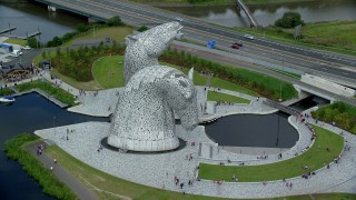AX109_128 - 6K stock footage aerial video of orbiting The Kelpies sculptures in Falkirk, Scotland