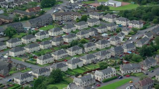 AX109_134 - 6K stock footage aerial video of residential neighborhoods with town houses, Falkirk, Scotland