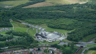 AX109_137 - 6K stock footage aerial video flyby Falkirk Wheel by trees, Scotland