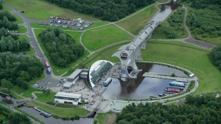 AX109_141 - 6K stock footage aerial video of a view of the Falkirk Wheel near trees, Scotland