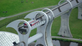 AX109_142 - 6K stock footage aerial video of ferries on the Falkirk Wheel boat lift, Scotland