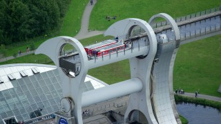 AX109_143 - 6K stock footage aerial video flyby ferries on the Falkirk Wheel boat lift, Scotland