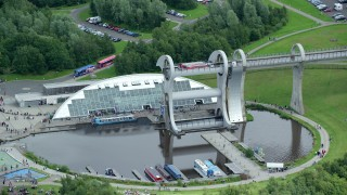 AX109_144 - 6K stock footage aerial video of ferries on the Falkirk Wheel boat lift, Scotland