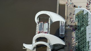 AX109_146 - 6K stock footage aerial video of orbiting two ferries on iconic Falkirk Wheel boat lift, Scotland