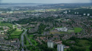 AX109_147 - 6K stock footage aerial video fly over Scottish neighborhoods and town, Falkirk, Scotland