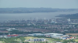 AX109_149 - 6K stock footage aerial video of a natural gas power plant along the water, Falkirk, Scotland