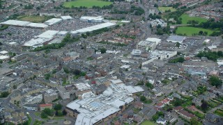AX109_150 - 6K stock footage aerial video of shopping center and strip mall in Falkirk, Scotland