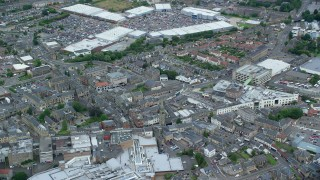 AX109_151 - 6K stock footage aerial video of orbiting shops and malls, Falkirk, Scotland