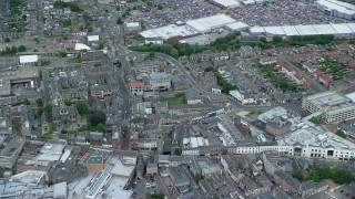 AX109_152 - 6K stock footage aerial video orbit shopping district in Falkirk, Scotland
