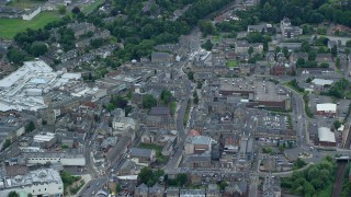 AX109_154 - 6K stock footage aerial video of town streets and buildings, Falkirk, Scotland