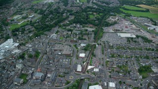 AX109_155 - 6K stock footage aerial video fly over train tracks, streets and buildings, Falkirk, Scotland