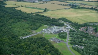 AX109_161 - 6K stock footage aerial video of the iconic Falkirk Wheel boat lift near trees and farmland, Scotland