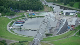 AX109_162 - 6K stock footage aerial video orbit and zoom in on Falkirk Wheel boat lift, Scotland