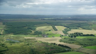 AX109_167 - 6K stock footage aerial video of farming fields and Scottish countryside, Bonnybridge, Scotland