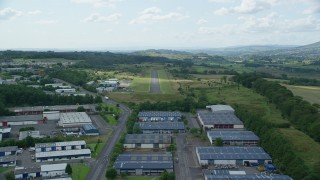 AX109_175 - 6K stock footage aerial video approach Cumbernauld Airport Runway, Scotland