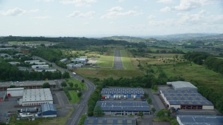 AX109_176 - 6K stock footage aerial video of an approach to the Cumbernauld Airport runway, Scotland