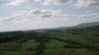 AX110_002 - 6K stock footage aerial video of green farmland in a rural landscape, Cumbernauld, Scotland
