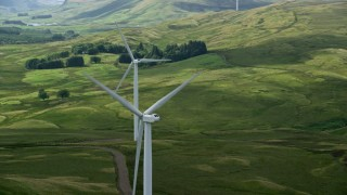AX110_015 - 6K stock footage aerial video of windmills and green countryside, Denny, Scotland