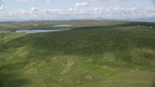 AX110_016 - 6K stock footage aerial video approach Earlsburn Reservoirs surrounded by green countryside, Scotland