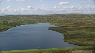 AX110_021 - 6K stock footage aerial video fly over Earlsburn Reservoir 2 and approach Gargunnock Hills, Scotland