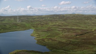 AX110_022 - 6K stock footage aerial video fly over Earlsburn Reservoir 2 and approach Gargunnock Hills, Scotland