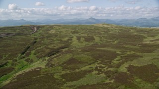 AX110_024 - 6K stock footage aerial video approach Carleatheran and fly over Gargunnock Hills, Scotland